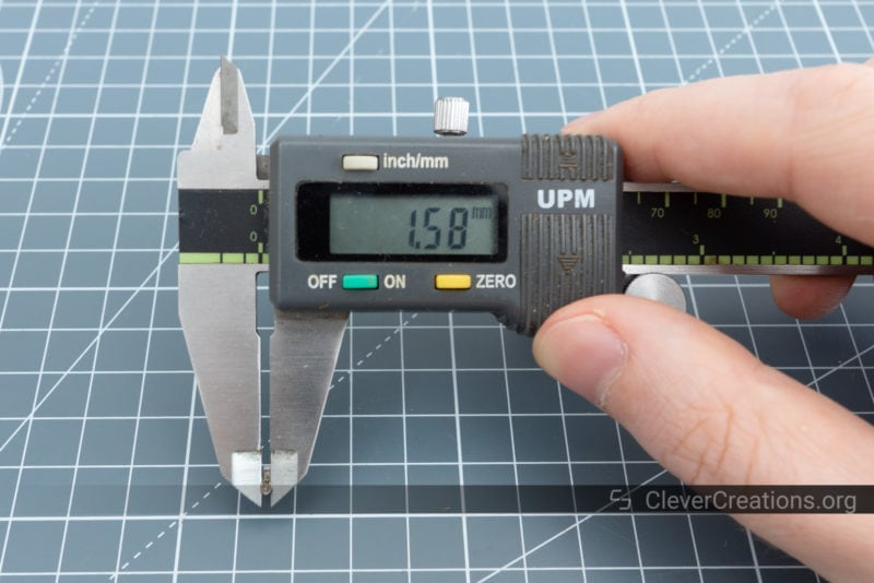 A digital caliper used to measure the width of a crimp contact in order to select the correct die size.