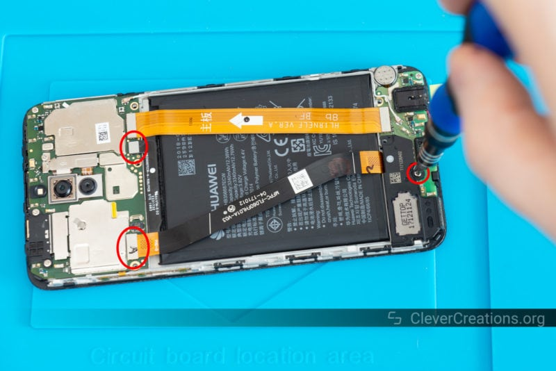 Three circled components on the circuit board of a Huawei phone.