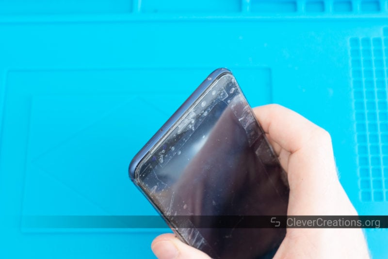 A repaired Huawei Mate 10 Lite with sections of tape temporary holding the screen in place while its adhesive dries.