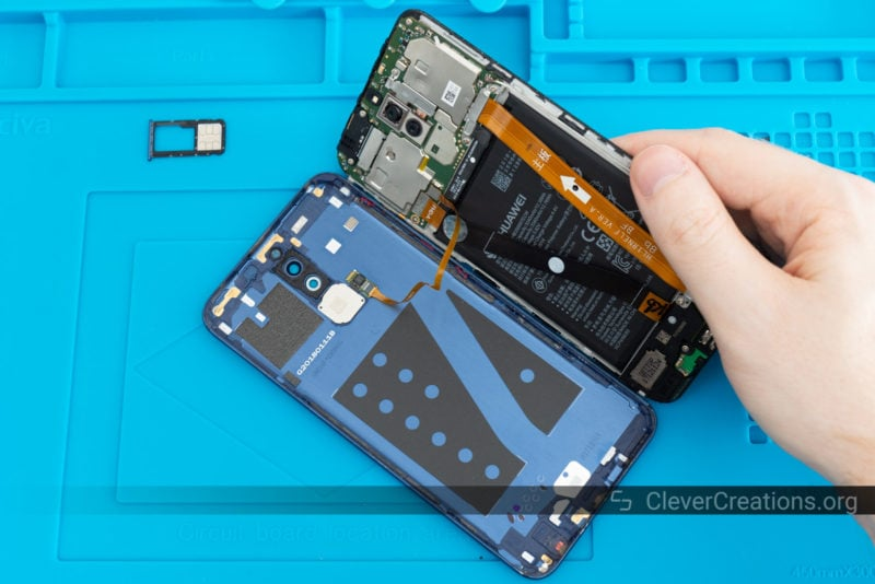 The inside of a Huawei Mate 10 Lite that is being repaired.