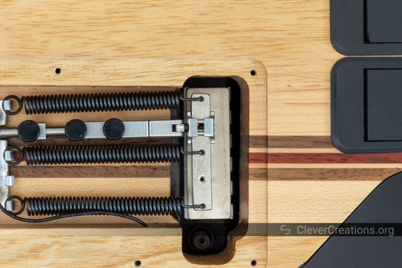 A Tremol-No small clamp placed onto an aluminium Floyd Rose block.